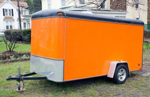 """Orange trailer with hitch. Horizontal.-For more trucks, trailers, and vans, click here."""